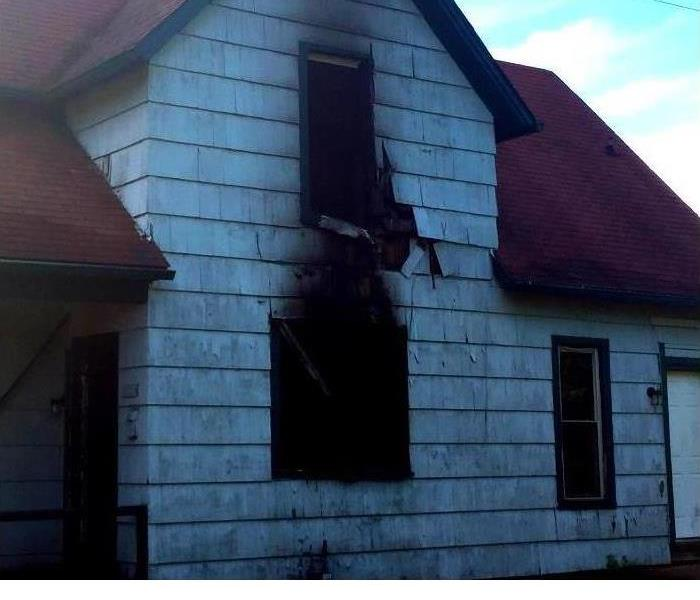 a home that has had fire damage with soot around the windows